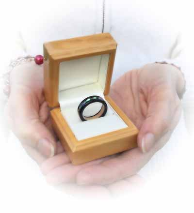 presenting an wooden engagment ring