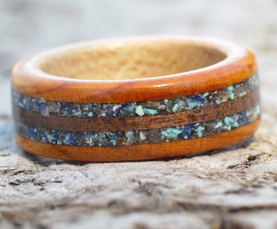 Shells and gemstones in a wooden ring